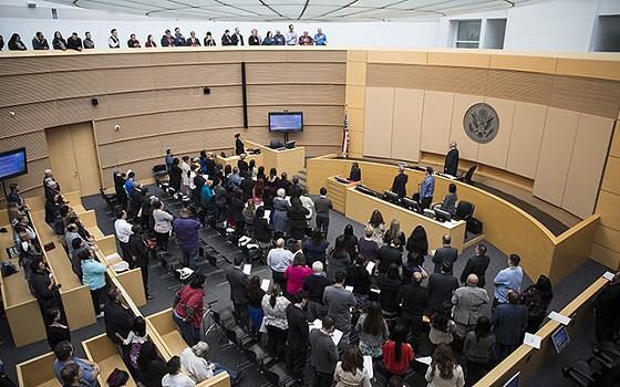 New citizens attend a swearing-in ceremony in February 2017. - JOHANNA HUCKEBA, CRONKITE NEWS