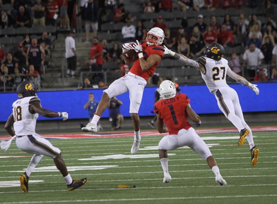 Shawn Poindexter leaps to snag an onside kick attempt in the fourth quarter of Arizona's 24-17 win over Cal on Saturday night. - CHRISTOPHER BOAN