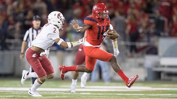 Arizona sophomore quarterback Khalil Tate strides past Robert Taylor of Washington State during the Wildcats 58-37 victory on Oct. 28, 2017. - CHRIS HOOK   ARIZONA ATHLETICS