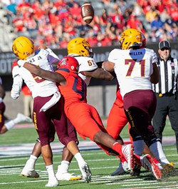 Arizona State's Manny Wilkins fumbles a throw as he's sacked by Arizona's Jalen Harris - PHOTOS BY SIMON ASHER