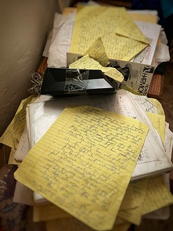 Piles of Billy's writings. - BRIAN SMITH