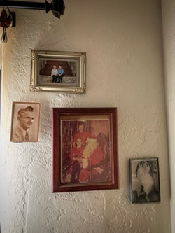 Family pictures on Billy's wall. - BRIAN SMITH