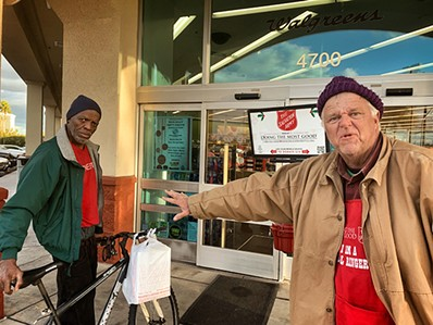 "Gregory Lewis the bell ringer and Charles at a Salvation Army ""Red Kettle"" outside of Walgreens. - BRIAN SMITH"