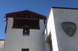 Mayor Jonathan Rothschild rings the bell at the Tucson Fire Department headquarters. - KATHLEEN KUNZ