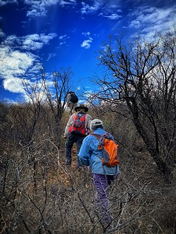 Ron, Andres and Alvaro move toward a death site. - PHOTOS BY BRIAN SMITH