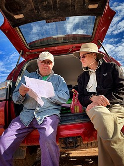 Alvaro Enciso (right) and Ron Kovatch study a map somewhere in the Sonoran Desert. - PHOTOS BY BRIAN SMITH