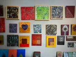 A wall of Alvaro Enciso's art inside his home. - BRIAN . SMITH