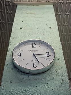 Clock ticks inside Giorsetti's. - BRIAN SMITH