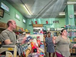Willam Giorsetti (left) with customers. - BRIAN SMITH
