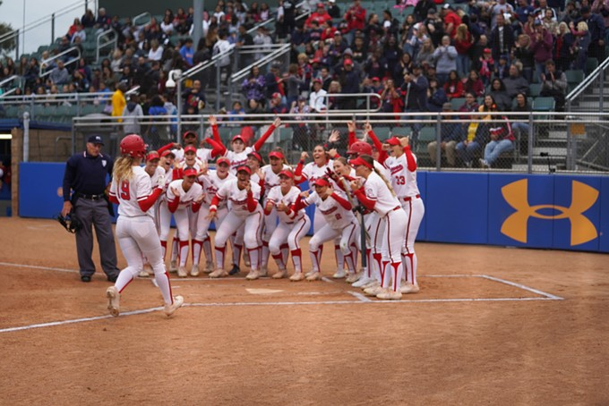 Arizona shortstop Jessie Harper is met by her teammates during the Wildcats' game against UCLA on Friday, May 10. - COURTESY CONNOR BUSS
