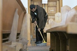 """Hermano Juan, a monk who drives up to Tucson from Elfrida with some of his colleagues, helps keep the monastery clean. """"We go outside the community,"""" he says. """"Our goal is to reach out to those in society that nobody wanted."""" - LOGAN BURTCH-BUSS"""
