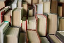 bigstock-stack-of-books-background-man-267003535.jpg