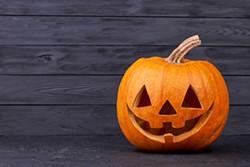 bigstock-halloween-pumpkin-with-happy-e-261030649.jpg