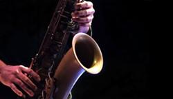 bigstock-jazz-musician-playing-the-saxo-312848242.jpg