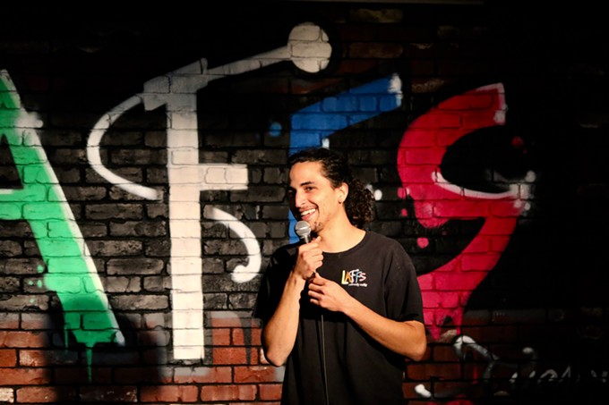 Comedian Marcus Gallego started at Laff's open mic when he was under age and had to stay in the Green Room when he wasn't performing. Now he produces shows, goes to all the mics and does tech and guest sets at Laff's. - CLAYTON BRAASCH