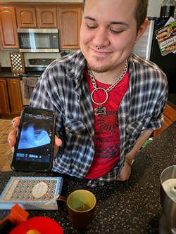 Cain and a shot from his ultrasound. - BRIAN SMITH