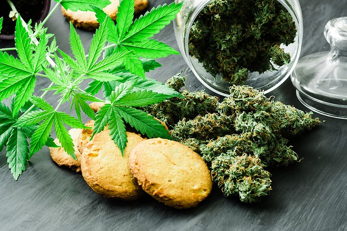 bigstock-cookies-with-cannabis-and-buds-242913877.jpg