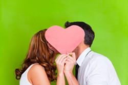 bigstock-young-couple-kissing-behind-pr-19421999.jpg