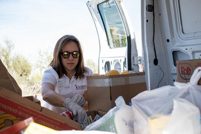 Lauryn Valladarez sorts through dry goods in the ICS van.