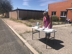 Volunteer Betts Putnam-Hildalgo sets up her table to host drive-up signature gathering at the Pima County Democratic Party Headquarters at 4639 E. 1st Avenue from 11 A.M. to 2 P.M. today through Saturday.