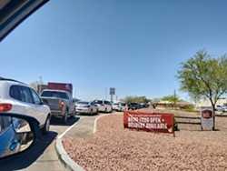 Long lines were the norm for the first few days of business amid the COVID-19 orders from Governor Ducey. - TARA FOULKROD
