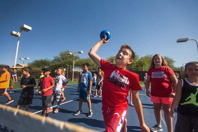 A camper throws a dodge ball at Oro Valley's 2016 summer camp at its community center. The town has camps planned this year, but the possible continuance of Gov. Ducey's stay-home order has thrown a wrench in the gears. - TUCSON LOCAL MEDIA FILE PHOTO