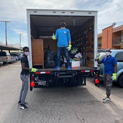 Volunteers for the Welcome to America Project deliver items to refugees from Eritrea and Congo earlier this month, when they also helped settle a young refugee in his first apartment. (Photo courtesy Mike Sullivan)