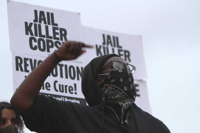 """After the vigil, a group of provocateurs overtook the stage to express their point of view on problems African-Americans face with law enforcement. """"Voting isn't going to do shit. We should not have to vote to be seen as a fucking human being. There's no such thing as a good cop. All cops are bad cops,"""" said the woman pictured above. """"Their job is to murder us. This whole 'be peaceful'...they killed those niggas in peaceful situations. Peace isn't gonna get us nowhere. We've been fucking peaceful. They're the ones to escalate."""" - AUSTIN COUNTS"""