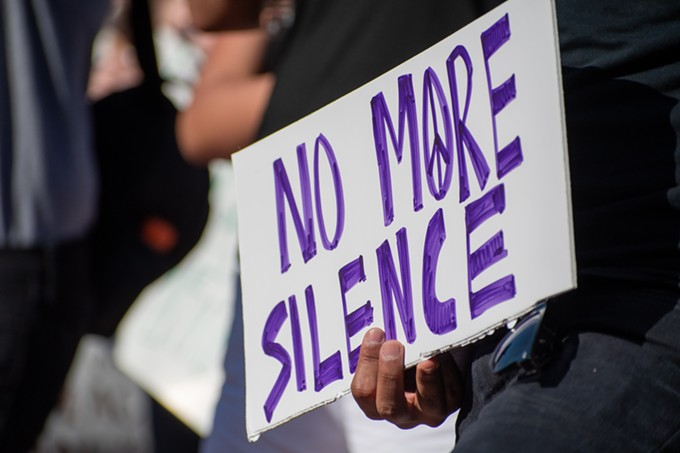No more silence was a coming theme, both among speakers at Wednesday's demonstration, and on attendees' signs. - LOGAN BURTCH-BUUS
