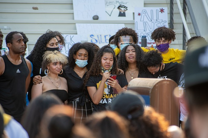 15-year-old Janel Drummer shares her personal experiences with racism while being comforted by her sister and supporters during Wednesday's demonstration. - LOGAN BURTCH-BUUS