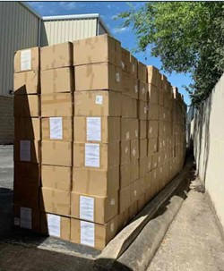A photo shared by Brennan Mulligan shows boxes he said are masks in storage.
