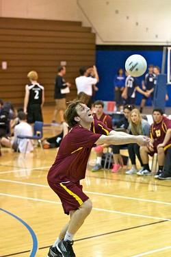 A Salpointe Men's Volleyball Team player shows off his hand-eye coordination skills.