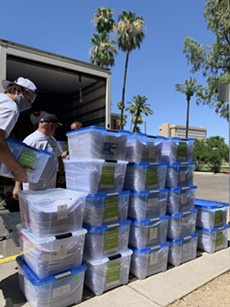 Volunteers for the citizens initiative Smart and Safe Arizona drop of a symbolic 420,000 signatures - ERIC CHALMERS