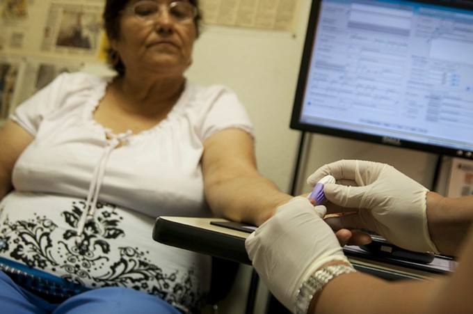 Ofelia Ocejo receives diabetes-management counseling at the El Rio Health Center. - TIM GLASS