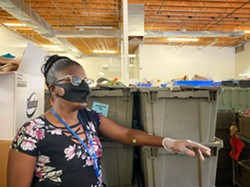 """Tawana Brown, working in the back of the store. """"When I was a girl, I dreamed of living in - an apartment like mine,"""" Brown says. """"I never thought I would ever be where I am."""" - BRIAN SMITH"""
