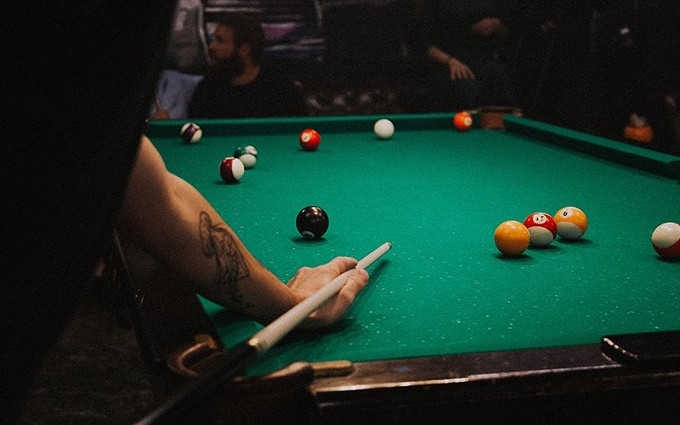 "Parlor games like darts and pool are prohibited under social distancing rules. Jamie Bates, manager of Bull Shooters Billiards & Sports Bar in Phoenix, says ""that hurts us."" - PHOTO BY KLARA KULIKOVA/CREATIVE COMMONS"