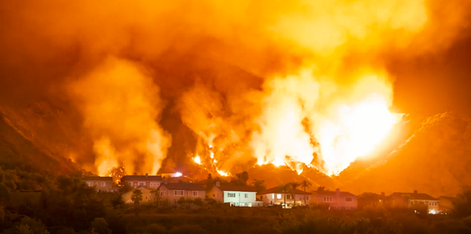 A wildfire on the foothills of the San Gabriel Canyon that border the Mountain Cove gated residential community in Azusa, Calif. The Ranch 2 Fire burned more than 4,200 acres. - (PHOTO BY JEFF FROST