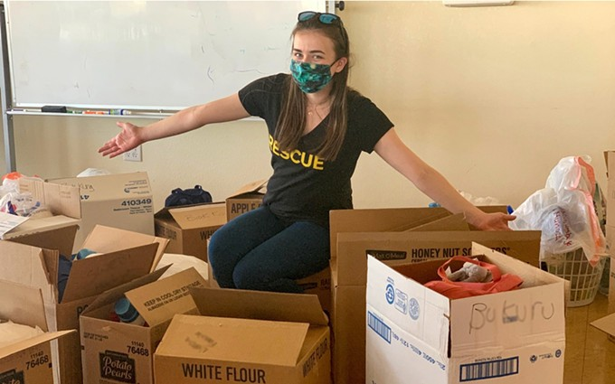 Bridget Ott, a senior health caseworker, prepares care packages for refugee families in Phoenix. Emergency care packages have been delivered to about 3,000 individuals in both Phoenix and Tucson since March. (Photo courtesy of International Rescue Committee