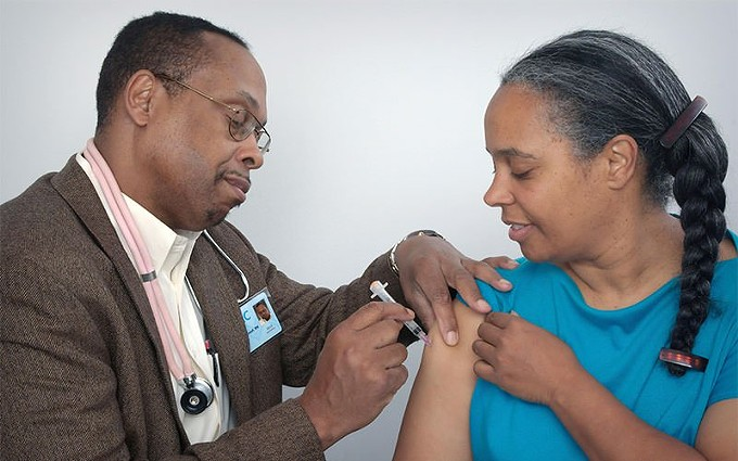 Researchers are urging more people of color to participate in clinical trials for a COVID-19 vaccine, but participation numbers so far are low. Black, Native American and Latino people are nearly 3 times more likely to contract COVID-19 than white people. Experts say vaccine trials should reflect that. - PHOTO COURTESY OF CDC