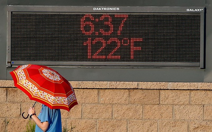 August and July were the hottest months on record in Phoenix, according to the National Weather Service in Phoenix. A new Arizona State study finds that as temperatures in Phoenix and other fast growing Sunbelt cities rise, so will human exposure to extreme heat. - PHOTO BY RALPH FRESO/GETTY IMAGES