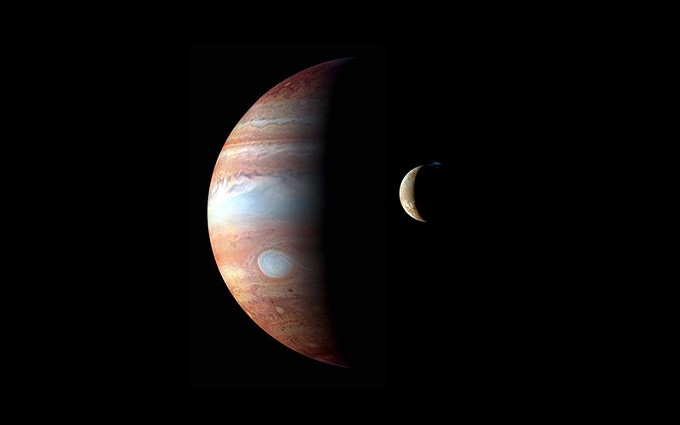 This montage of images taken by the New Horizons spacecraft in 2007 shows Jupiter and one of the planet's volcanic moons, Io. This moon's magma is helping scientists understand tidal heating between moons. - PHOTO COURTESY OF NASA/JHUAPL
