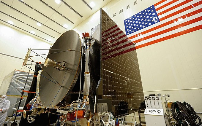 """Final assembly in 2015 of the OSIRIS-REx spacecraft, which launched in 2016. University of Arizona teams had been working on the project for more than a decade when it reached a near-Earth asteroid, Bennu, this week and executed a touch-and-go mission to briefly """"tag"""" the surface, collect soil samples and head back to orbit. - LOCKHEED MARTIN"""