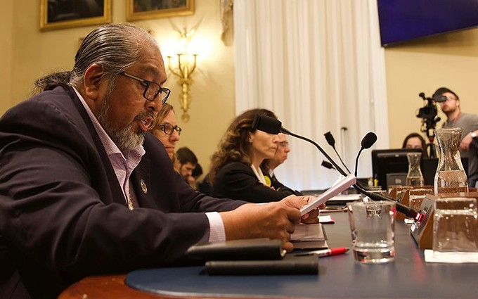 """Tohono O'odham Chairman Ned Norris Jr. teared up at one point in his testimony as he described how blasting of sites for border wall construction has """"totally destroyed"""" and """"forever damaged"""" his people. He aid was not alerted of blasting on the """"final resting place"""" for many of his tribe's ancestors until the day of the work. - JESSICA MYERS/CRONKITE NEWS"""