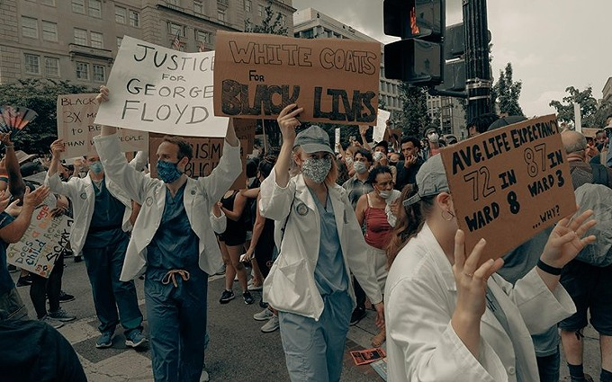 Doctors and nurses joined protesters around the country at Black Lives Matter rallies held in the aftermath of the killing of George Floyd last year. The deaths of Floyd, Breonna Taylor and other Black people at the hands of police sparked a new racial reckoning, and several governors and state legislators have since declared that racism is a public health crisis. - CLAY BANKS/UNSPLASH