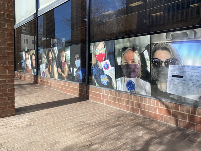 The Pima County superintendent's office is decorating their windows with pictures of educators who've received a COVID-19 vaccine. - MATT STAMP