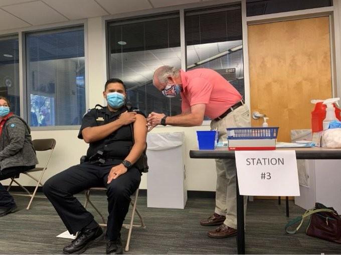 University of Arizona President Dr. Robert C. Robbins vaccinates a University of Arizona police officer. - THE UNIVERSITY OF ARIZONA