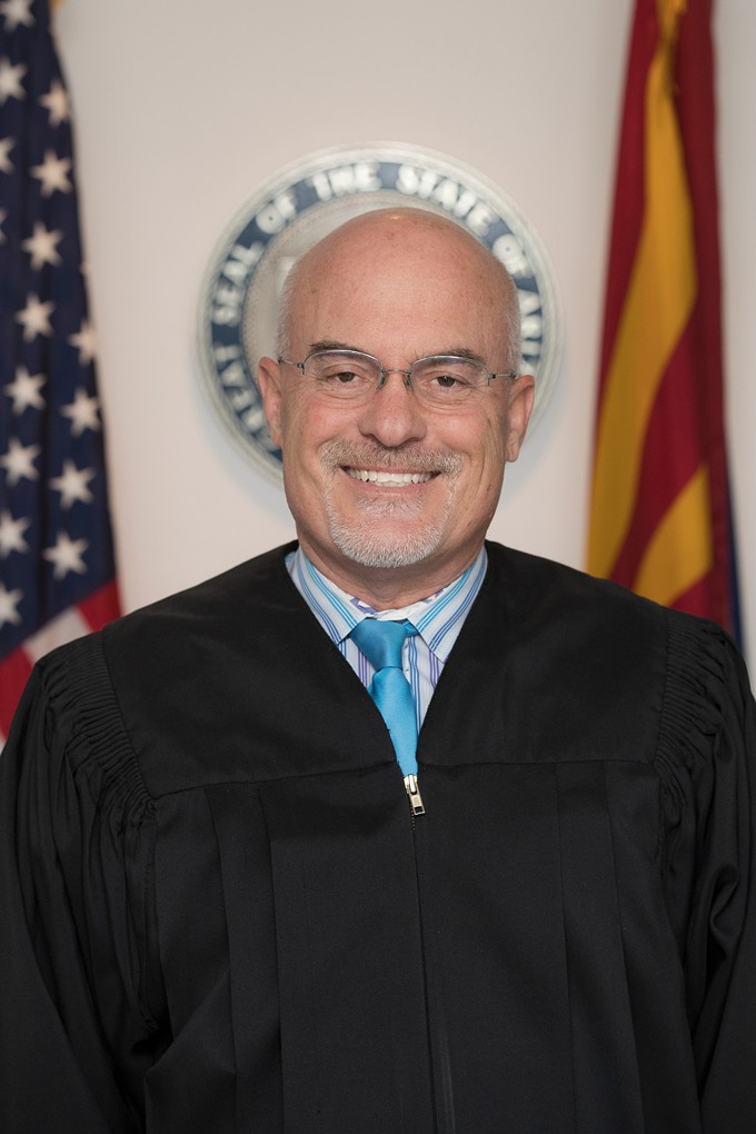"""Justice of the Peace Adam Watters told police he fired a """"warning shot"""" at a man he believed had been harassing him by dumping trash in his front yard. - PIMA COUNTY JUSTICE COURT"""