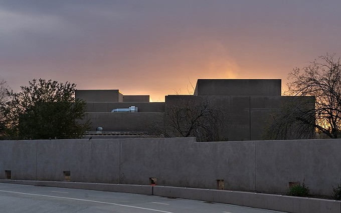 Pale smoke rises from the Paradise Memorial Crematory in Scottsdale. Maricopa County in April lifted a regulation preventing crematoriums from operating past sunset, helping them deal with the increased number of COVID-19 deaths. - KEVIN PIREHPOUR/CRONKITE NEWS