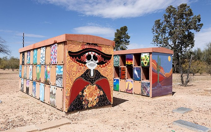 The Pima County Office of the Medical Examiner in Tucson, Arizona, built three concrete boxes in the Evergreen Mortuary Cemetery in north Tucson that contain unidentified remains. A high school art class has painted the boxes in a celebration of life. - RAPHAEL ROMERO RUIZ/CRONKITE BORDERLANDS PROJECT