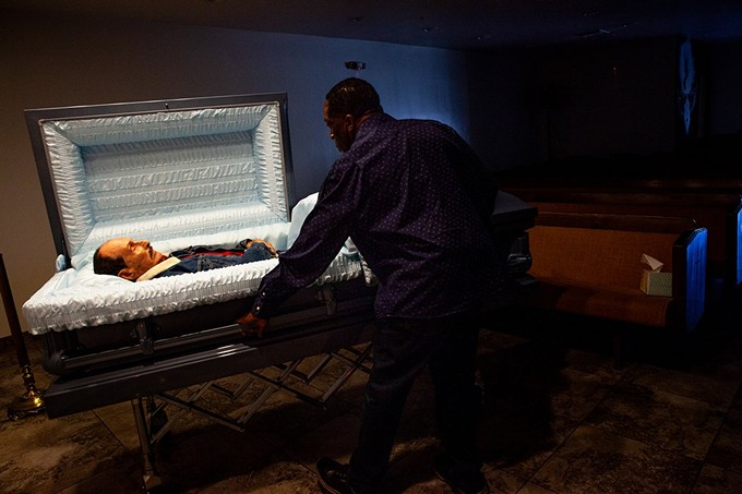 """Funeral director Ron Thornson prepares for a service at Peace Chapel Funeral Home in Phoenix. The funeral industry has been one of the hardest hit during the pandemic, but these """"last responders"""" often are among the least recognized for providing essential services. - PHOTOS BY ALBERTO MARIANI/CRONKITE NEWS"""